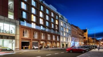 """Moderní projekt nazvaný """"Dva Domy"""" vyplní současnou proluku v Křižíkově ulici a svým architektonickým pojetím vytvoří městotvorný prvek navazující na stávající budovy."""